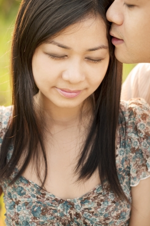 Close up Loving Asian couple whispering Stock Photo - 9507121