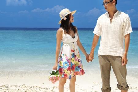 Asian couple having a great time at the island, Lang Tengah, Malaysia Stock Photo