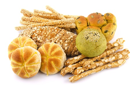Variety of Organic Breads on white background photo