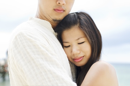 Loving Asian Couple at outdoor beach photo