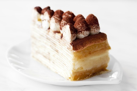 mille: Portion of Tiramisu Mille crepe on a plate Stock Photo