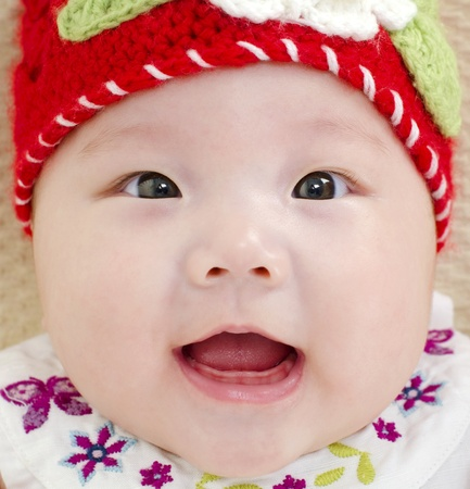 oriental ethnicity: 5 months old Asian baby girl smiling Stock Photo