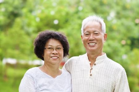 Asian Senior Couple at outdoor park Stock Photo - 9782643