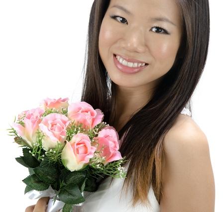 Beautiful Asian bride isolated on white background photo
