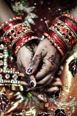 bangles hand: An Indian bride and the henna artwork on her hands