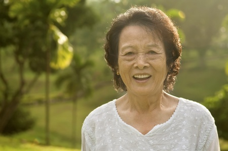 80s Asian senior woman at park in a morning photo
