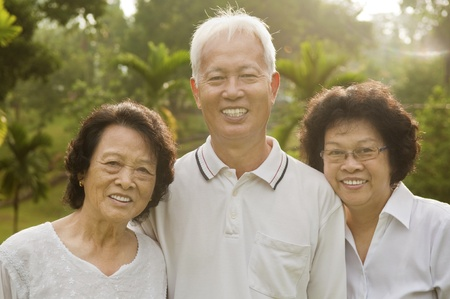 citizen: Three Senior Asian Smiling happily at park in a morning.