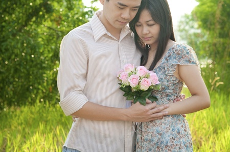 Loving Asian Couple at outdoor photo
