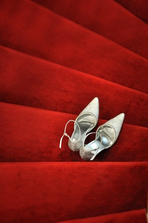 White bridal shoes on red carpet photo