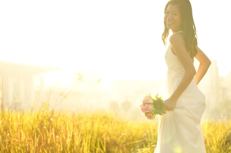 asian bride: Asian bride at outdoor in a morning surrounding by golden sunlight