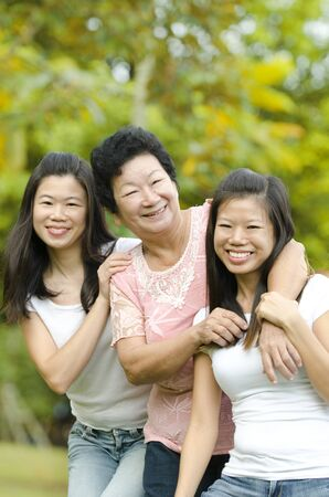 black asian: Happy Asian Senior lady and her daughters