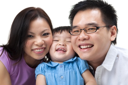 Happy Asian family on white background Stock Photo - 9899667