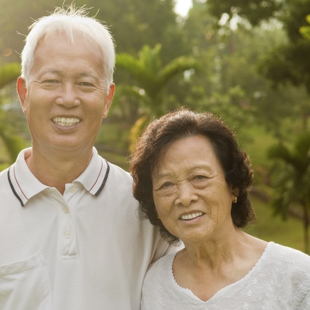 Asian Senior Couple at outdoor park photo