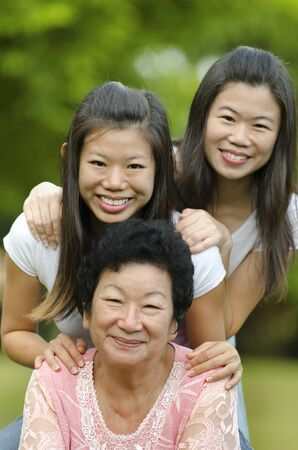 adults offspring: Happy Asian Senior lady and her daughters