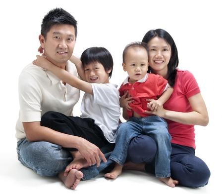 asia family: Happy Asian family sitting on white background