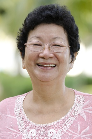 60s Asian senior woman smiling at outdoor Stock Photo - 10060423