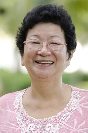 60s Asian senior woman smiling at outdoor Stock Photo - 10060423
