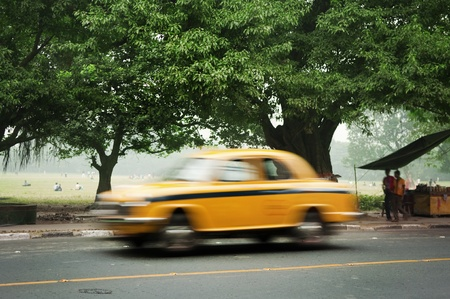 Motion blurred of old taxi in Calcutta (Kolkata), West Bengal, India. photo