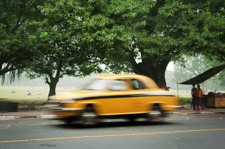 calcutta: Motion blurred of old taxi in Calcutta (Kolkata), West Bengal, India.