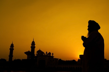 sikhism: Silhouette of Sikh prayer at temple, Amritsar, India