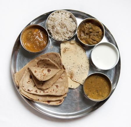 subcontinent: A thali is a selection of different dishes, usually served in small bowls on a round tray.