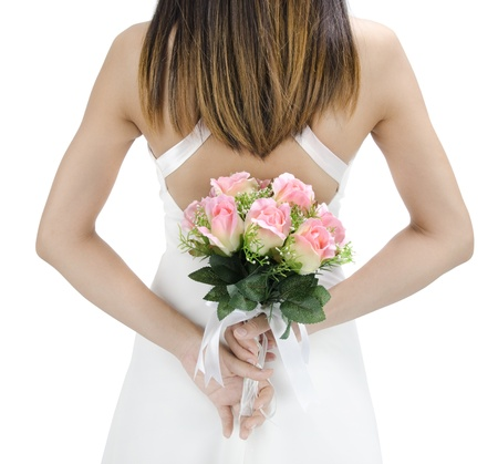 Bride holding her bouquet behind her back Stock Photo - 10143524