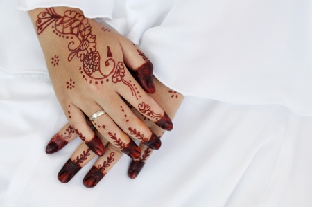 Malay bride and the henna artwork on her hands photo