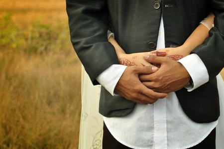 Close-up of a bride and groom in an embrace.  photo