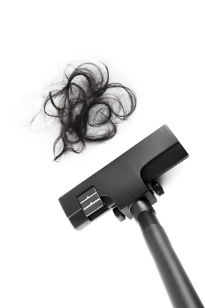 hair problem: Vacuum cleaning fall hair on white background