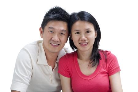 Loving Asian Couple on white background photo