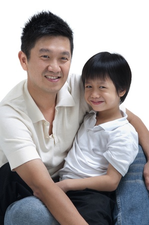 Father and son on white background photo