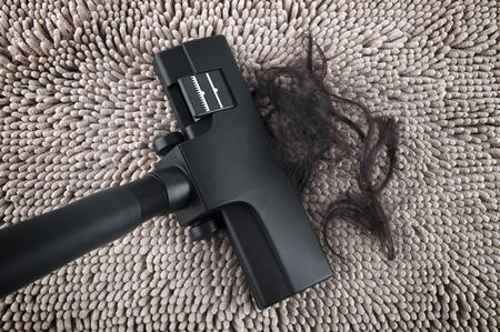keeping room: Vacuum cleaning fall hair on carpet