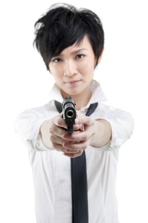 Cool Asian bodyguard holding a gun photo