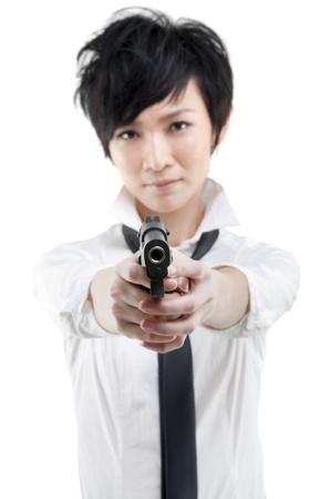 gripping hair: Cool Asian bodyguard holding a gun