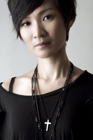 short hair: Cool girl on plain background Stock Photo