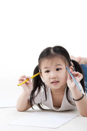 writing activity: Little girl looking for a drawing concept Stock Photo