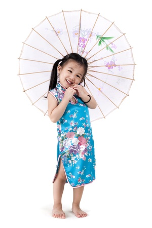 traditional dress: Little oriental girl in traditional Chinese dress cheongsam with umbrella Stock Photo