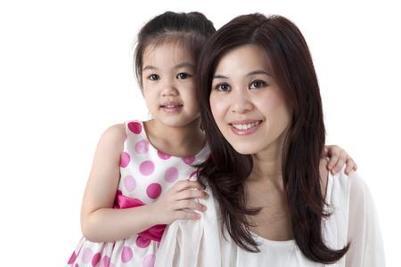 母親和女兒在白色背景 版權商用圖片