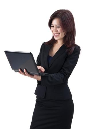 Asian women using laptop over white background Stock Photo - 10567176
