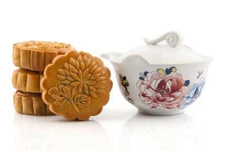 yellow tea pot: Moon Cake and Tea Set of Mid Autumn Festival Stock Photo