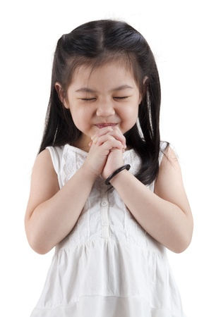 clasped: Little girl wishing on white background