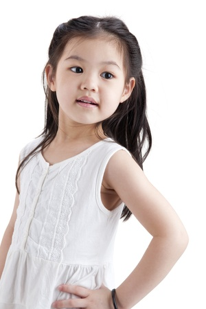 little girl posing: Little Asian girl in white dress on white background