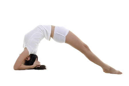 Woman in yoga, Inverted Staff Posture (Dvi Pada Viparita Dandasana), on white background photo