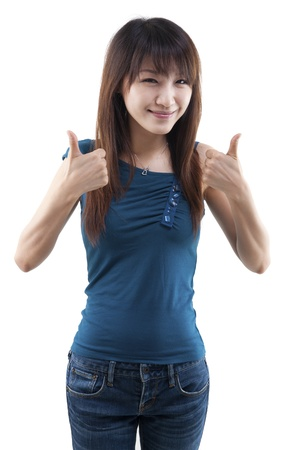 Asian female thumbs up with great smile. photo