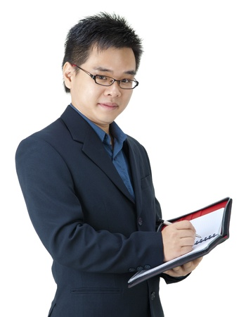 financial planner: Asian Executive with his diary Stock Photo