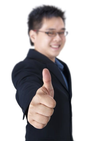 Businessman giving an enthusiastic thumb up photo