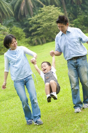 Happy Asian family walking in the park Stock Photo - 11012265