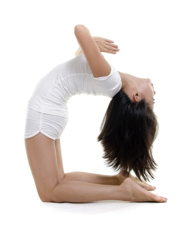 kneeling woman: Woman in yoga, Camel Posture (Ustrasana), on white background
