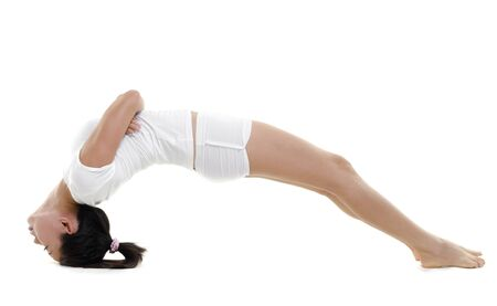 Woman in yoga, BridgePosture (Setu Bandhasana), on white background photo