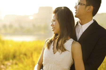 Outdoor Bride and Groom, surrounding by natural morning golden sunlight. photo